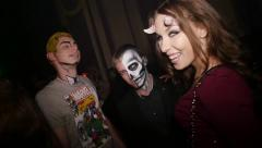Celebrating Halloween in nightclub in costume party. Slow motion Stock Footage