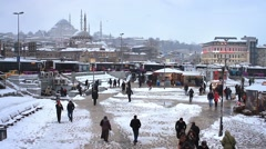 People stroll on the snow along Pier of Golden Horn at Eminonu in Istanbul City. Stock Footage