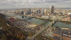 Aerial shot of Pittsburgh, PA zooming out to Mt. Washington ridge Stock Footage