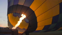 Hot Air Balloon being inflated side view - stock footage