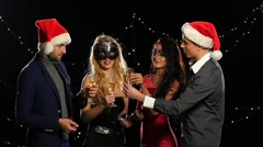 Boys and girls with flutes of champagne wishing you Merry Christmas. Slow motion Stock Footage