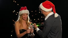 Emotional happy couple opening champagne on New Year's eve. Slow motion Arkistovideo