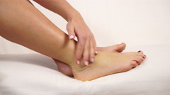 Woman putting ointment on bad ankle close up 4K Stock Footage