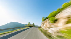 4K 25p Hyperlapse sunny day drive pov mountain road countryside Stock Footage