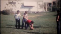 Stock Video Footage of 2705 - boys have a friendly football game in backyard - vintage film home movie