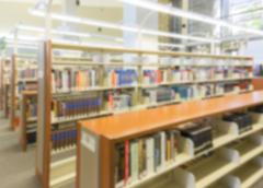 Blurry Interior Library Aisle Background. Stock Photos