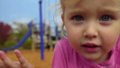 Little girls shrugs her shoulders Stock Footage