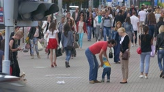 Ungraded: Crowd of People Walking Along Busy Street in Summertime Stock Footage