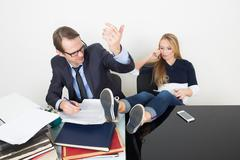 man and woman are incompatible. business office employee, lazy girl - stock photo