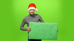 Brutal man in Christmas hat. green screen, blank sign Stock Footage