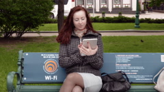 Girl Browsing Internet With Tablet - stock footage