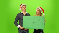 Couple celebrating new year eve. green screen, blank sign Stock Footage