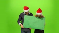 Man and woman: new year's eve. green screen, blank sign Arkistovideo