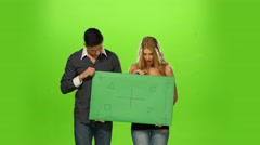 Couple holding up a blank sign, green screen Stock Footage