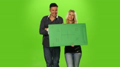 Energetic and  beautiful Couple holding up a blank sign, green screen Stock Footage