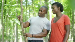 4K Attractive African American couple exploring in the woods.  Stock Footage