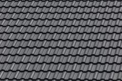 Stock Photo of black tile roof on building residence house