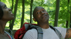 4K Attractive African American couple hiking in the woods Stock Footage