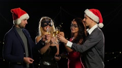 Smart colleagues with flutes of champagne wishing you Merry Christmas, on black Stock Footage
