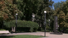 City park in summer. View of statue and lights - stock footage