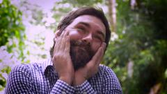 Portrait of a bearded man being dreamy or love struck Stock Footage