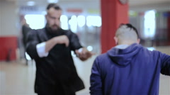 Training with Kung Fu two young boys - stock footage