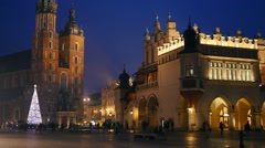 Krakow Market Square in the nighttime with christmas decorations Stock Footage