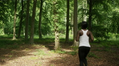 4K Attractive African American couple going for a run in the woods Stock Footage