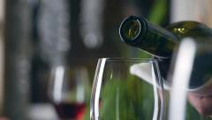 Sommelier filling glass with wine in restaurant - stock footage