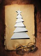 Christmas tree cut out from paper and glasses Stock Photos