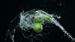 Apple colliding against water splash. Slow Motion. Stock Footage