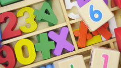 Rotating multi-colored toy wooden numbers. Stock Footage