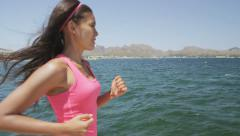 Woman Sport Athlete Running and Jogging By Sea - Female Runner Workout Stock Footage