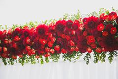 Beautiful floral decoration for outside wedding ceremony made of red flowers. Stock Photos