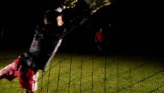 Stock Video Footage of Young Men Play Football Penalty Kick