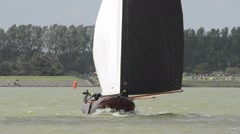 Classic sailboat sailing on a lake Stock Footage