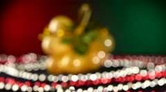 Toy like grapes for Christmas or New Year and beads, rotation, on red and green Stock Footage