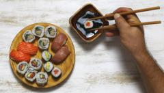 Eating sushi and dip in sauce Stock Footage