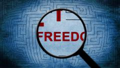 Magnifying glass on freedom maze Stock Footage