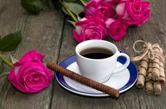 Beautiful still life, coffee, roses and linking of cookies Stock Photos