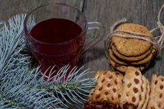 cup of tea, fir-tree branch and two linking of cookies - stock photo