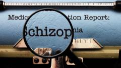 Magnifying glass on schizophrenia medical report Stock Footage
