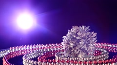 Unusual silver toy for Christmas or New Year and beads, rotation, back light, on - stock footage