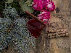 fir-tree branch, tea, linking of cookies and bouquet of roses, subject holida - stock photo