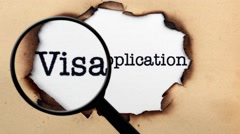 Magnifying glass on visa application Stock Footage