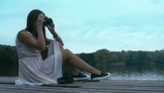 HD cinemagraph - attractive Caucasian woman taking pictures with vintage camera Stock Footage