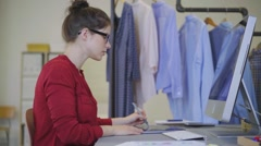 Fashion designer working at her computer Stock Footage