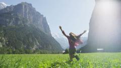 Carefree Woman Enjoying Happy in Mountains Running Free And Joyful Stock Footage