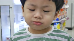 Boy pretending to vomit after eating ice cream. - stock footage