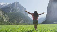 Carefree Woman Turning Around Happy in Mountains - Girl Is Free And Full Of Joy - stock footage